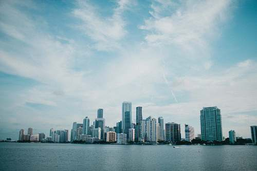 city landscape photography of city beside body of water high rise