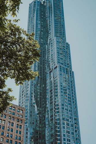 housing low angle photo of curtain glass wall building city