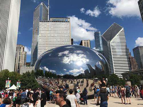 city people walking on park near cloud gate during daytime downtown