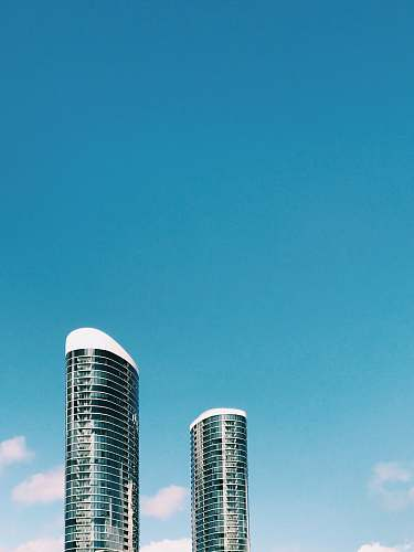 condo white and black high rise building under blue sky during daytime housing