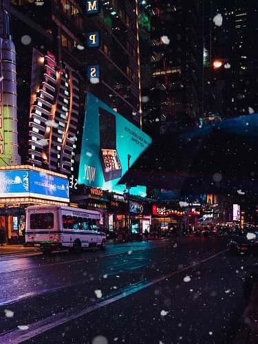 urban white bus in city street at night city