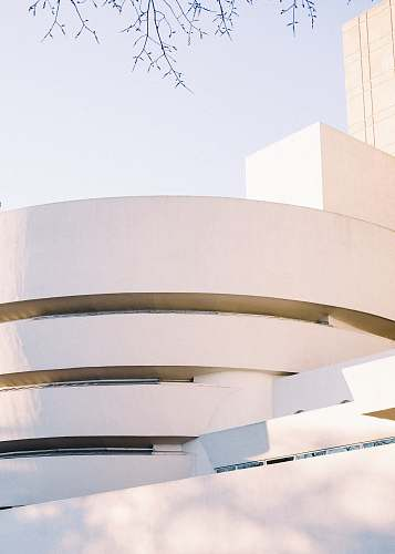 photo solomon r. guggenheim museum white concrete building during daytime new york free for commercial use images