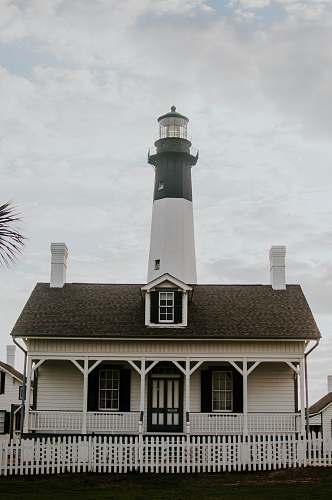 photo beacon white lighthouse under white sky cottage free for commercial use images