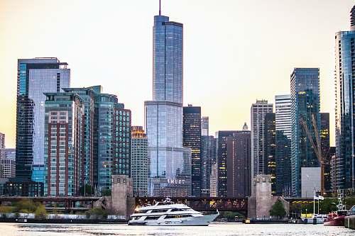 city white yacht near dock high rise