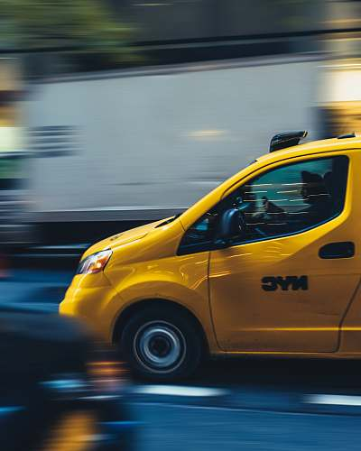 photo taxi time lapse photography of yellow car automobile free for commercial use images