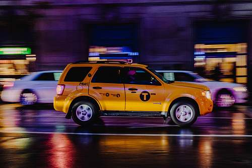 taxi yellow SUV vehicle