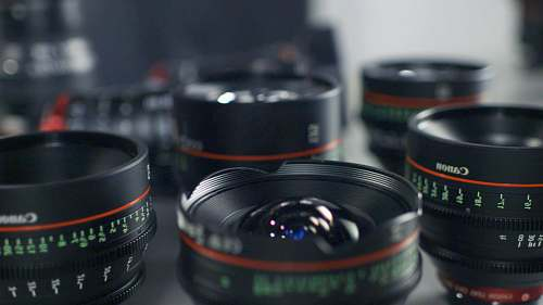 electronics selective focus photography of Canon lenses cup