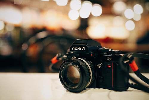 nikon selective focus photography of black Nikon MILC-camera boston