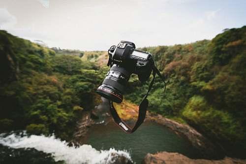 levitation trowed black Canon DSLR camera canon