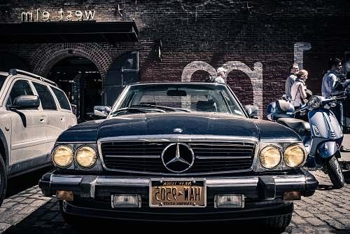 vehicle closeup photo of classic black Mercedes-Benz car transportation