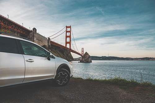 bridge wide angle photo of Golden Gate Bridge vehicle