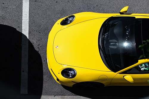 tire yellow Porsche car miami design district