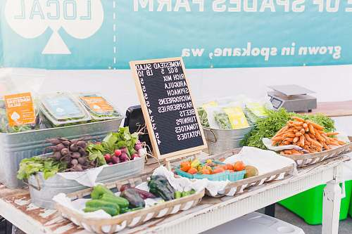 produce variety of vegetables with price sign on table flora
