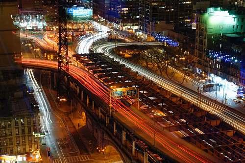 urban aerial view of roadway bridge during night time building