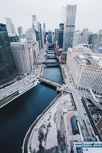 chicago aerial view photography of city buildings with body of water architecture