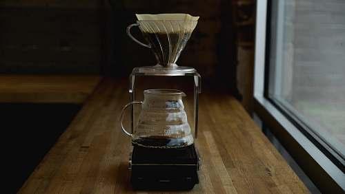hourglass coffee pitcher on table near window jackson