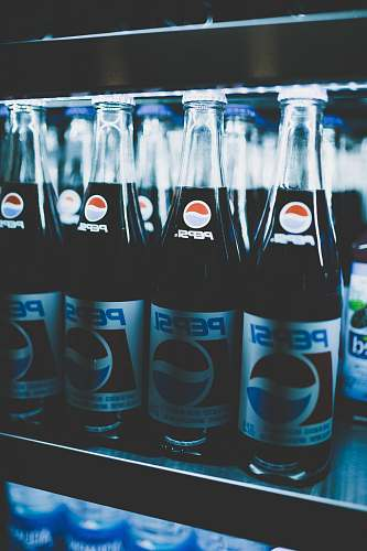 beverage Pepsi bottles on cooler drink
