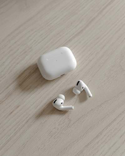 electronics white apple airpods on brown wooden table hardware