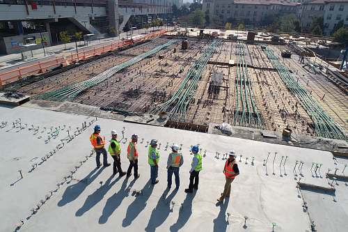 human seven construction workers standing on white field person