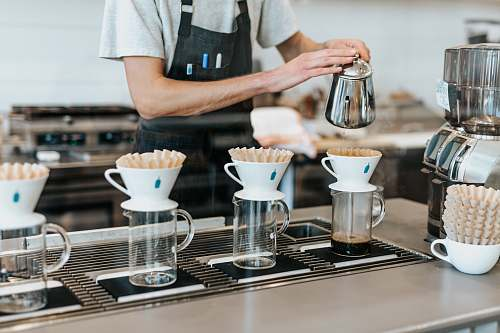 coffee man pouring on cup blue bottle coffee