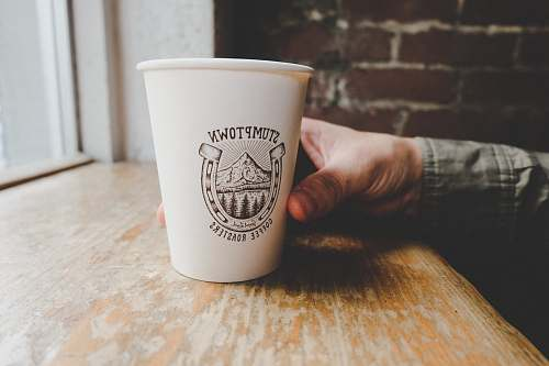 coffee cup person holding white disposable paper cup portland
