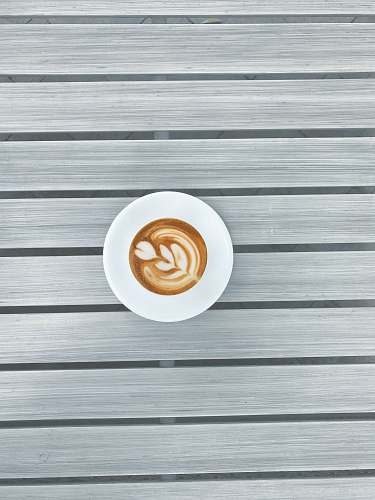 beverage round white espresso coffee on grey striped surface drink