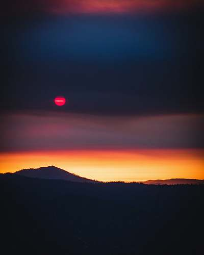 dusk silhouette view of mountain under red moon nature