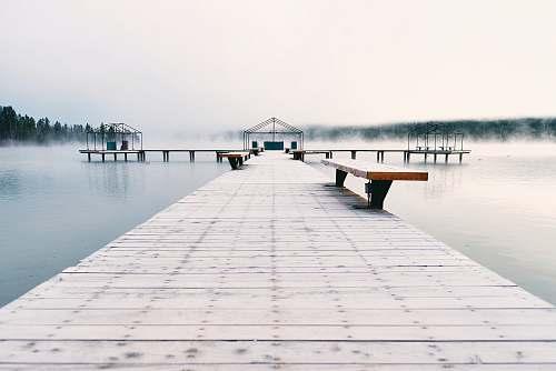 pier brown bench on brown wooden bridge bench