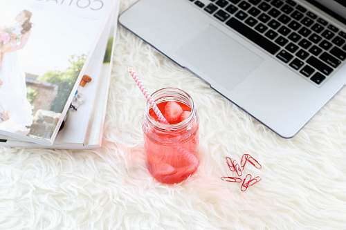 work clear mason jar with red liquid and straw new york