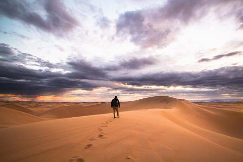 sand man walking on desert glamis