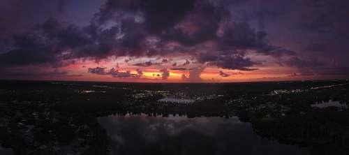 sky scarlet skies near water sunrise