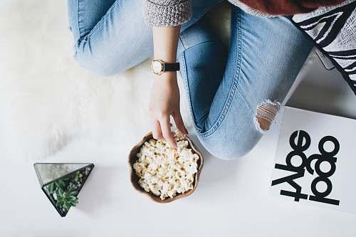 gemstone person holding popcorn on bowl jewelry