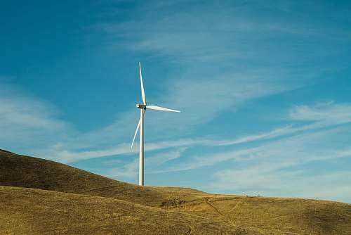 machine white windmill on hill during daytime motor