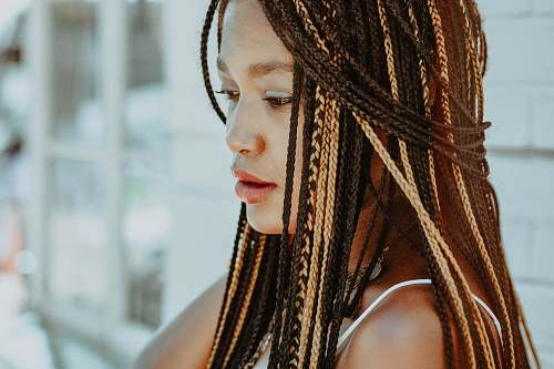 girl selective focus photography of woman with braided hair woman