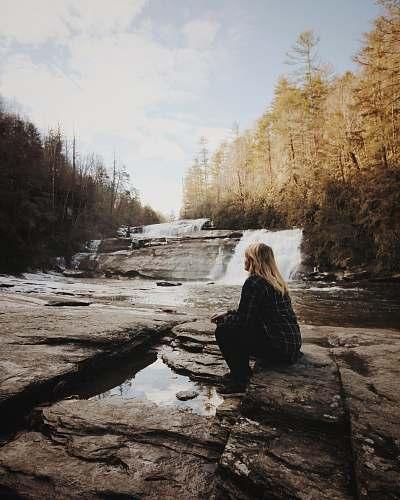 blonde woman sitting near falls girl