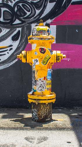 hydrant yellow fire hydrant near wall wynwood