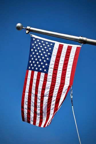 emblem USA flag on pole empire state building