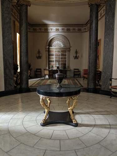 floor brown vase on round black marble centerpiece table furniture