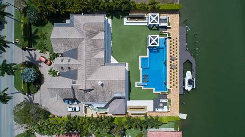 naples bird's eye view of house with pool near body of water jar