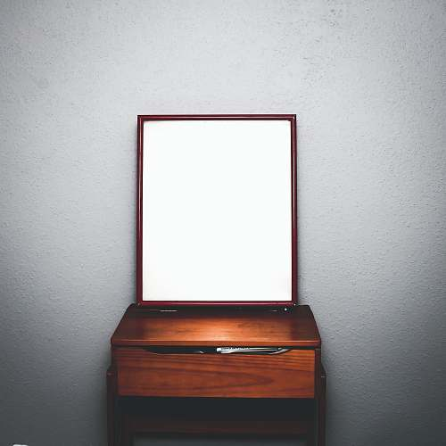missouri city brown wooden dresser with mirror inside white room united states