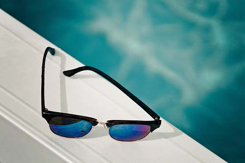 sunglasses clubmaster sunglasses on white surface blue