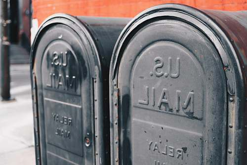 mailman close view of two gray U.S mailboxes philadelphia