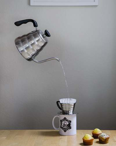 tap gray kettle pouring cup