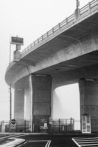 bridge grayscale photo of bridge black-and-white
