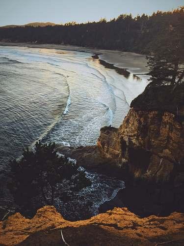 nature high angle photo of sea coast