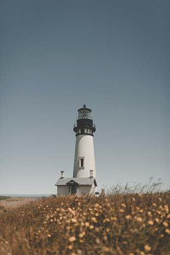 architecture lighthouse under blue sky beacon