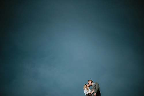 boone low angle photography of couple kissing under blue sky united states