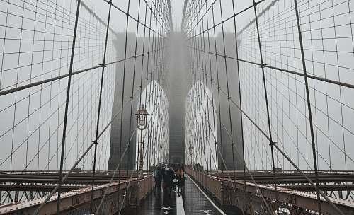 bridge people walking on Brooklyn Bridge building
