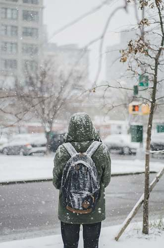 brooklyn person standing under pouring snow snow