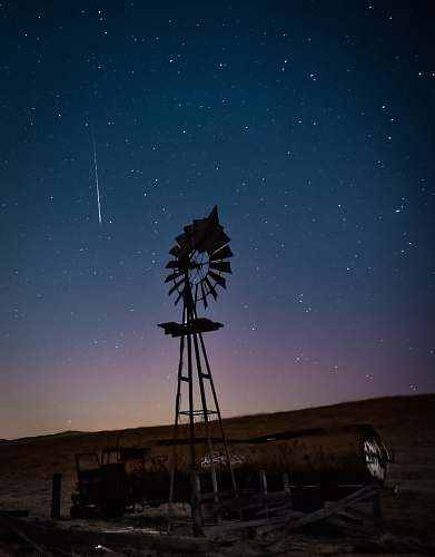 nature photo of windmill during nighttime rural